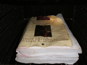 My Blackwell Companion to Continental Philosophy book drying out in a low oven
